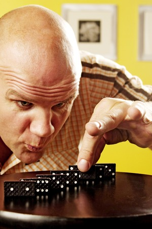 Man playing dominos