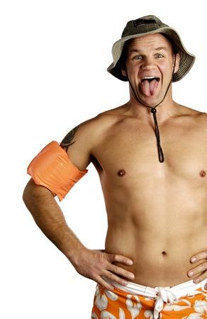 Shirtless man sticking out his tongue photo