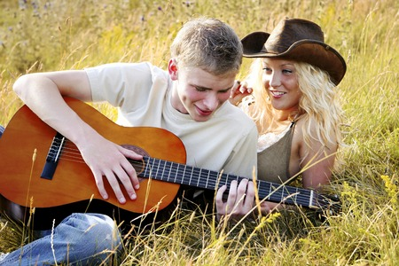 captivation: Man playing guitar for his girlfriend