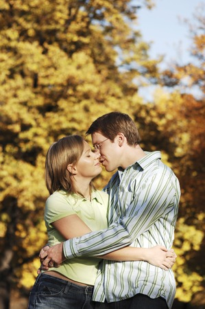 Couple kissing in the park photo