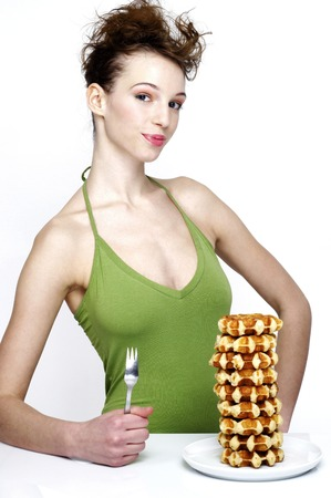 stacked up: Woman with a plate of stacked up doughnuts