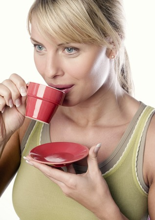 flavoursome: Woman drinking a cup of coffee Stock Photo