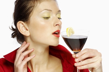 flavoursome: Woman drinking a glass of red wine Stock Photo