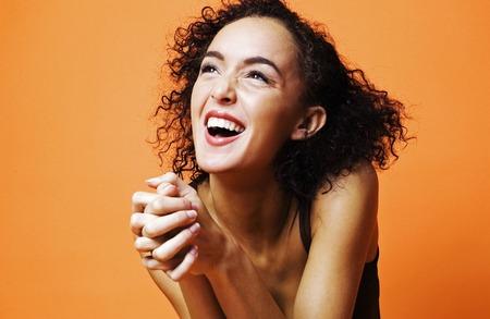 gratified: Woman laughing
