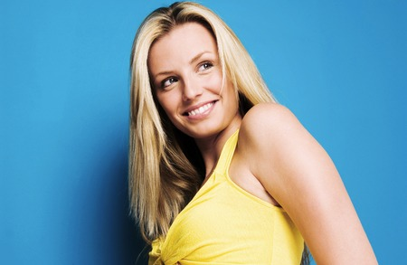 Woman posing and smiling Stock Photo - 26142377