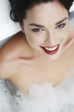 Woman relaxing in the bathtub photo