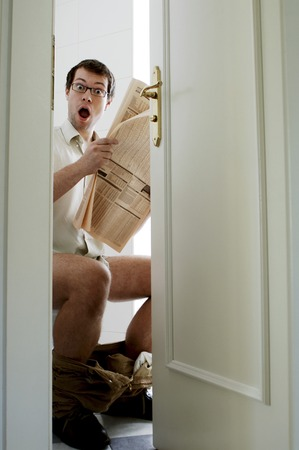 inconvenient: Man on toilet bowl in shock