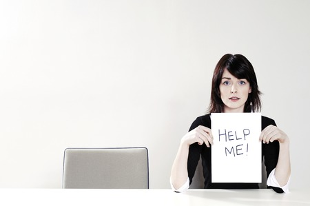 help me: Businesswoman holding a Help Me sign Stock Photo