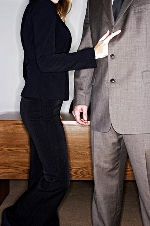 groping: Woman seducing businessman