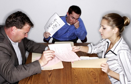 An uninterested man holding a 'Rescue Me' sign during a transaction