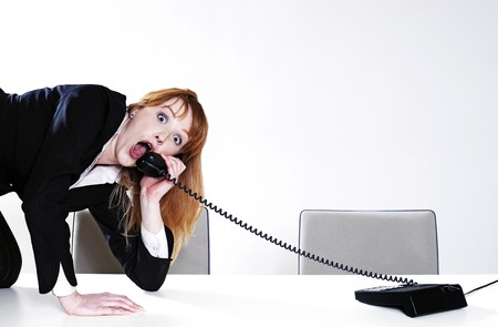 uncomfortable: Businesswoman answering call in an uncomfortable way
