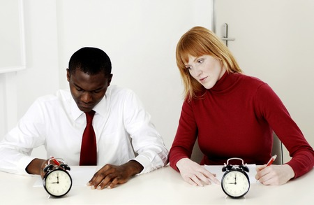Businesswoman copying her colleagues work during a test Stock Photo