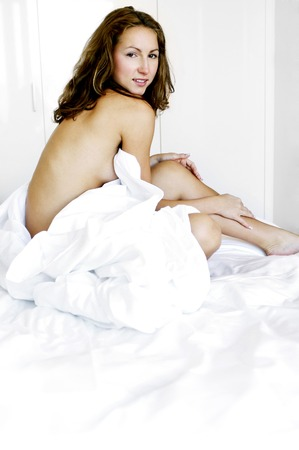 Woman sitting on the bed photo