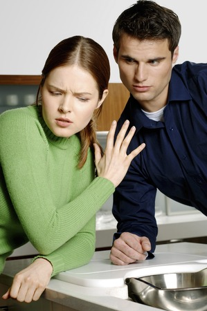 Man trying to console his angry girlfriend photo