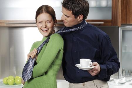 Woman pulling her boyfriends tie