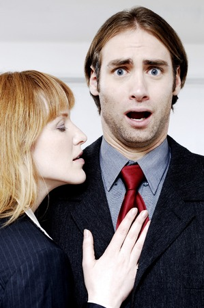 Businesswoman seducing her colleague photo