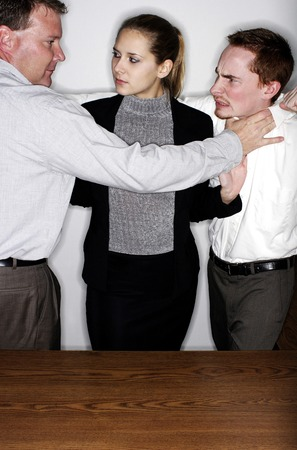 Businesswoman trying to cool off two angry men photo