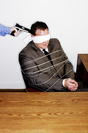 Businessman being robbed photo