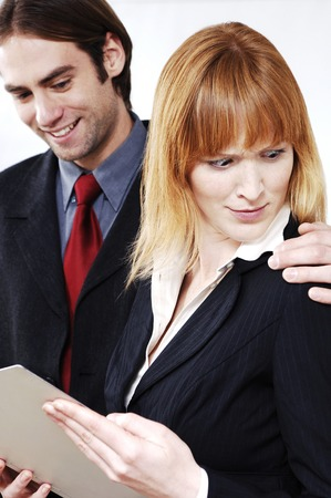 groping: Businesswoman in shock with her colleagues behaviour Stock Photo