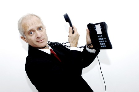 messed up: Phone cord entangling around businessmans neck Stock Photo