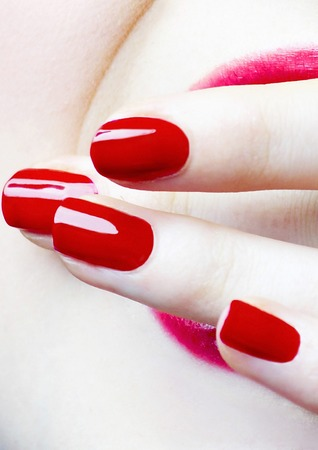 Red coloured finger nails photo