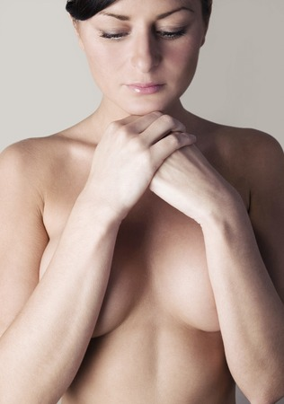 Topless woman looking sad photo