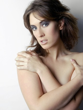 Topless woman covering her breasts photo
