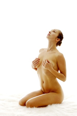 Nude woman covering her breasts photo
