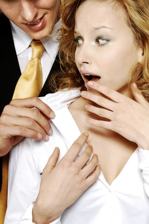 Businesswoman shocked with her colleagues behavior photo