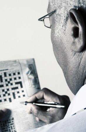 Businessman doing crossword puzzle Stock Photo
