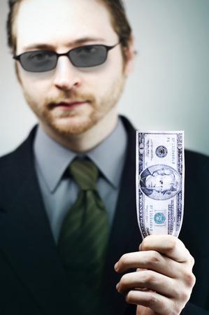 Businessman holding US dollar Imagens