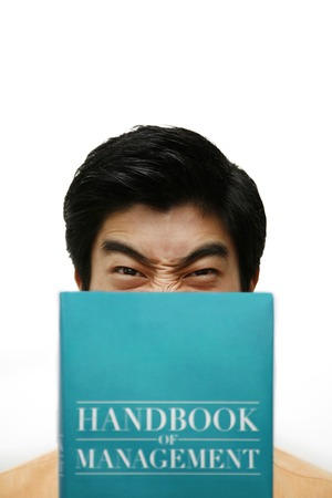 handbook: Man holding handbook of management Stock Photo