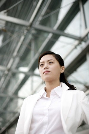 Businesswoman staring blankly at a space Stock Photo