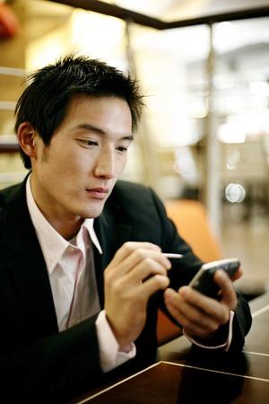 palmtop: Businessman using palmtop PDA