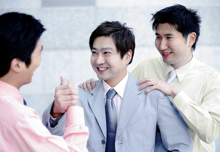 desirous: Businessmen greeting each other