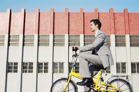 desirous: Businessman cycling to work