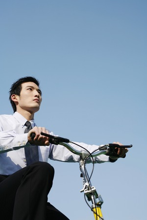 Businessman cycling to work photo