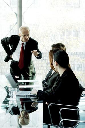 Manager scolding his subordinates