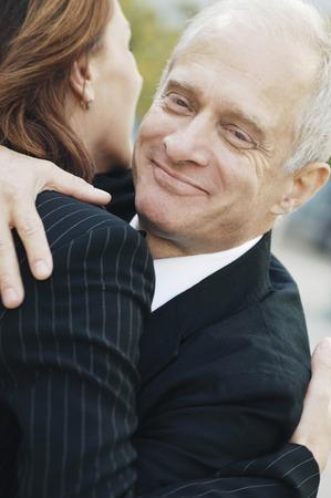Businessman giving his client a hug