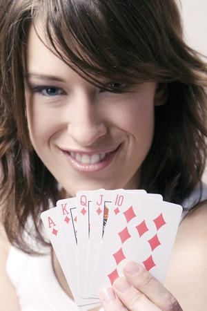 Woman holding playing cards Stock Photo