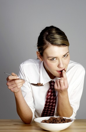 Businesswoman having breakfast cereal