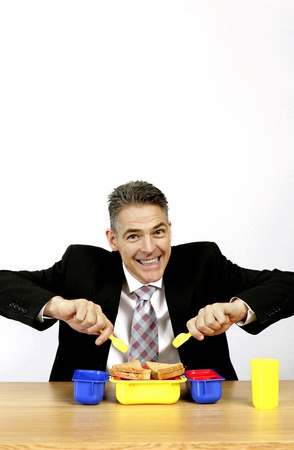 Businessman eating bread from his lunch box