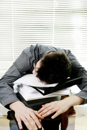 Businessman sleeping on the table photo