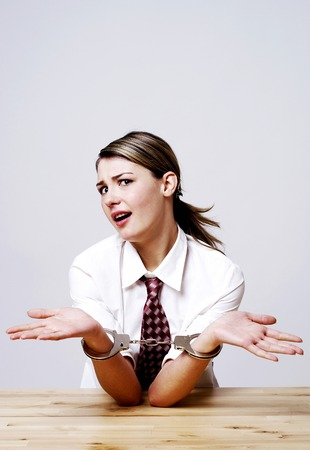 handcuffed: Businesswoman being handcuffed Stock Photo