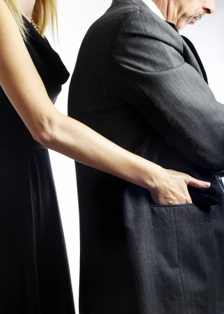 pickpocket: Female pickpocket stealing from a businessman