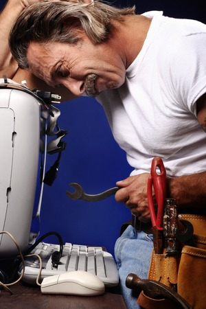 figuring: Man trying to fix his computer