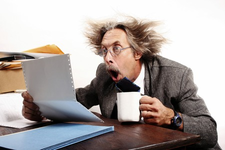 bespectacled man: Businessman in shock after reading the sales report Stock Photo