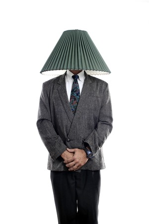 lamp shade: Businessman with a lamp shade covering his head