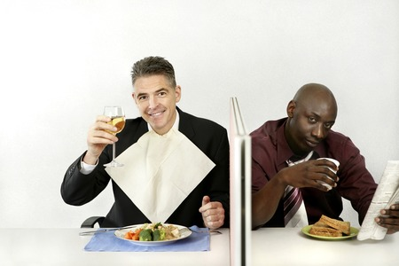 he is different: Businessmen enjoying their meal Stock Photo