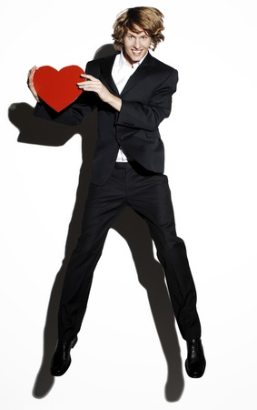 Businessman holding a red heart photo